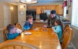 Family at the dining table having a snack