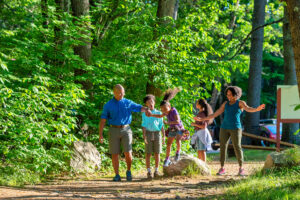 family hiking in summer