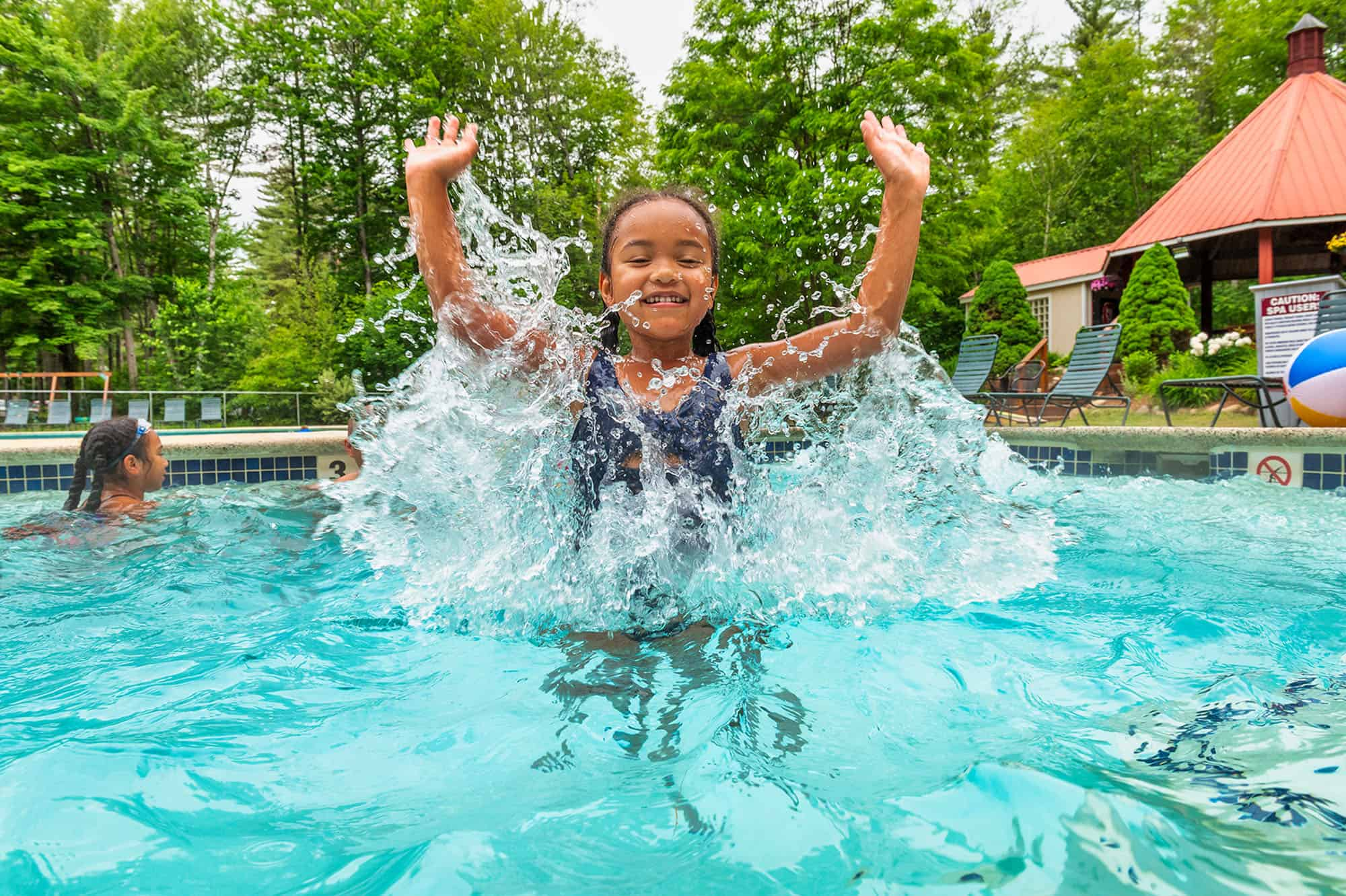 child in outdoor pool