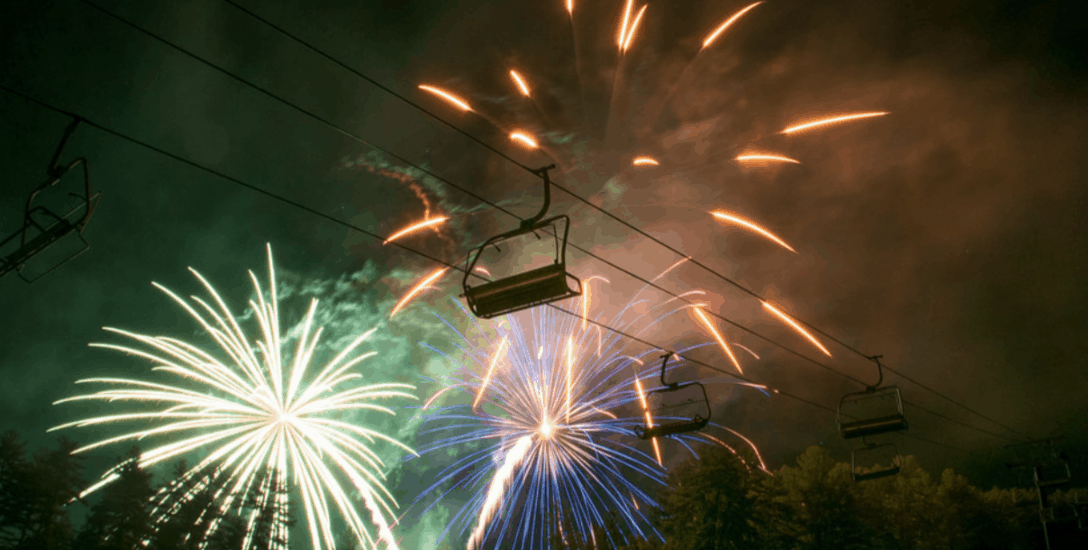 Chairlift with fireworks in background