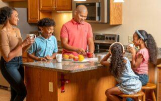 Family gathering in spacious kitchen