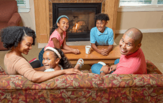 happy family around the fireplace
